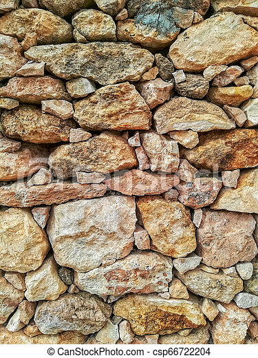 Brown stone wall - csp66722204
