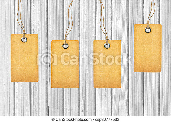 Brown tags on wooden background - csp30777582