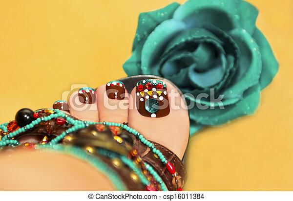 Brown turquoise design pedicure. - csp16011384