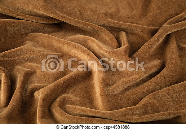 brown velvet close-up. Fabric macro for texture and background - csp44581888