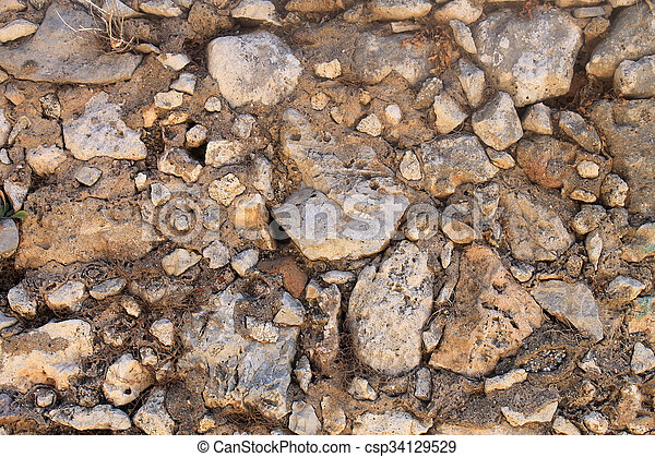 brown weathered stone wall background - csp34129529