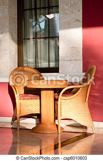 Brown wooden chairs an tables on patio - csp6010603