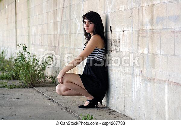 Brunette at a Block Wall (2) - csp4287733