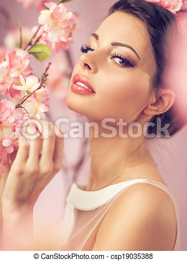 Brunette beautie with the flowers - csp19035388
