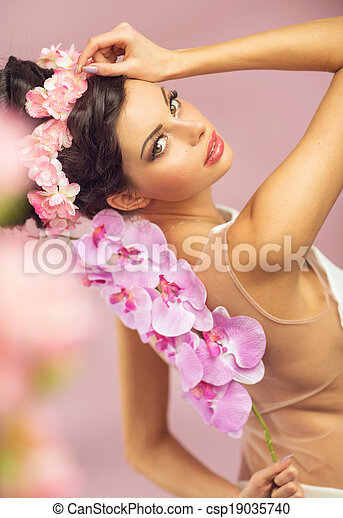 Brunette beautie with the spring flowers - csp19035740