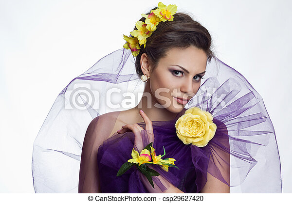 Brunette beautiful woman with flowers - csp29627420