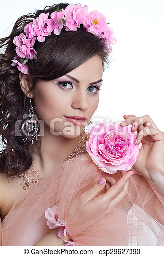 Brunette beautiful woman with flowers - csp29627390