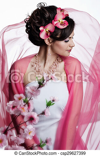 Brunette beautiful woman with flowers - csp29627399
