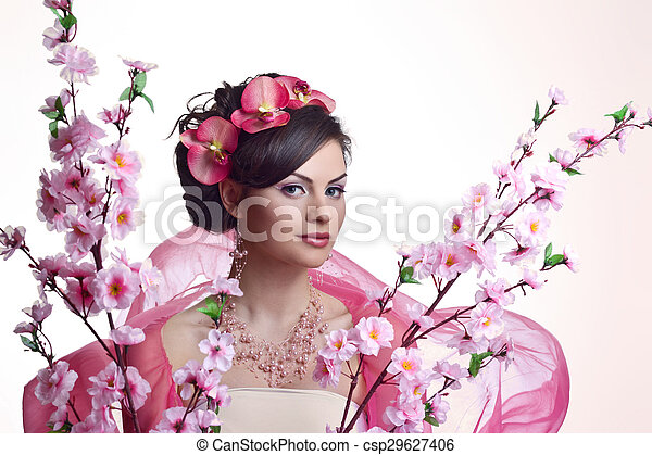 Brunette beautiful woman with flowers - csp29627406