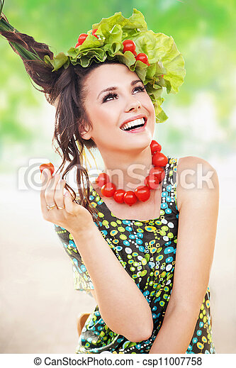 Brunette beauty posing with a tomato - csp11007758