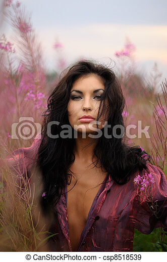 Brunette Beauty With Pink Blooms - csp8518539