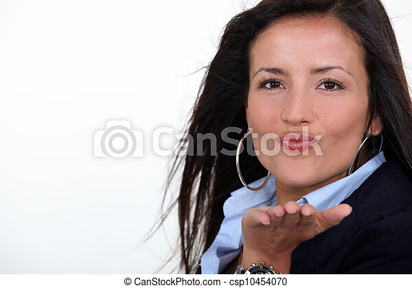 Brunette blowing kiss - csp10454070