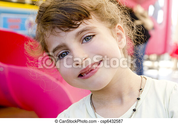 brunette indented girl smiling in red playground - csp6432587