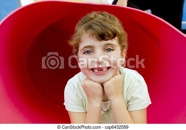 brunette indented girl smiling in red playground - csp6432589