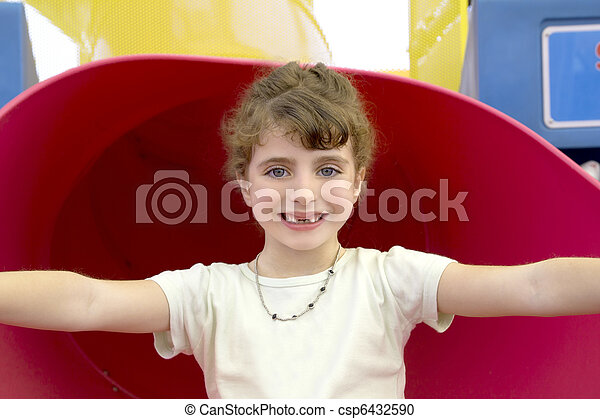 brunette indented girl smiling in red playground - csp6432590