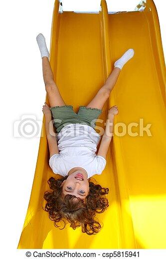Brunette little girl upside down playground slide - csp5815941