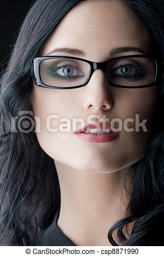 brunette wearing glasses - csp8871990