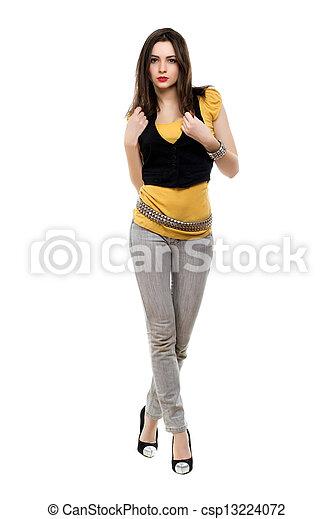 Brunette wearing grey jeans - csp13224072