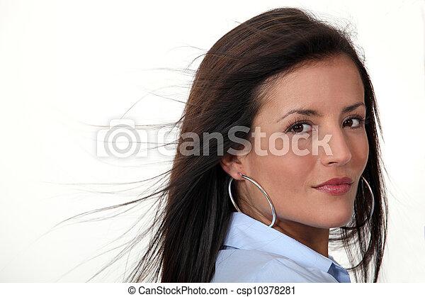 Brunette wearing hoop earrings - csp10378281