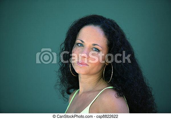 Brunette wearing hoop earrings - csp8822622