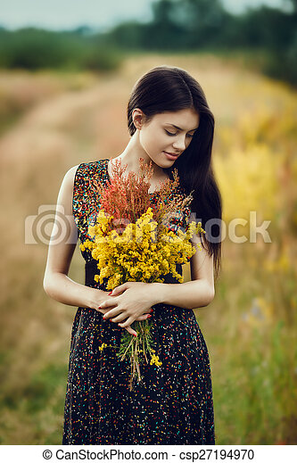 Brunette with flowers - csp27194970