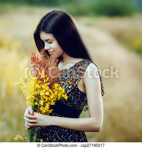 Brunette with flowers - csp27195017