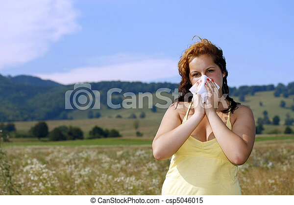 brunette woman having a pollen allergy in the nature - csp5046015