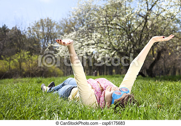 Brunette woman in funny glasses lies at meadow. - csp6175683