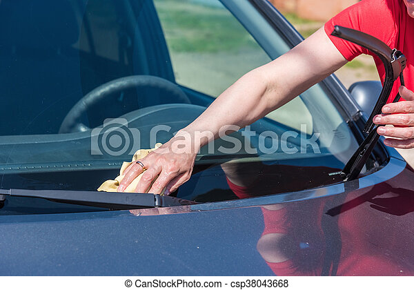 brunette woman washes her car - csp38043668