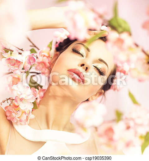 Brunette woman with flowers in her hair - csp19035390