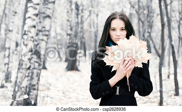 Brunette woman with maple leaves - csp2628938