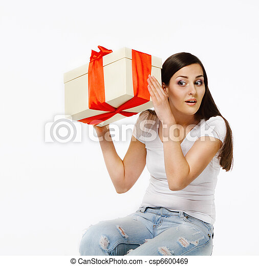 Brunette woman with present - csp6600469