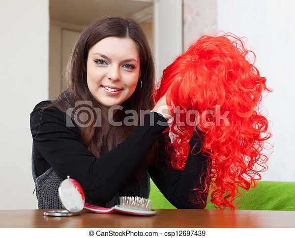 brunette woman with red periwig - csp12697439