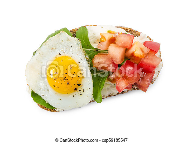 Bruschetta with tomato, fried egg and arugula isolated on white - csp59185547