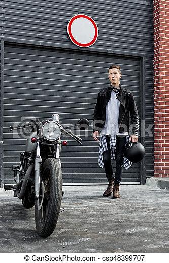 Brutal Man Near His Cafe Racer Custom Motorbike