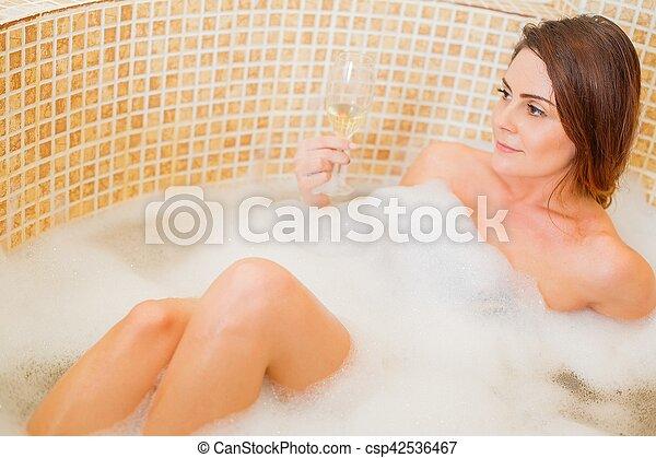 Lesbian blonde in bubble bath