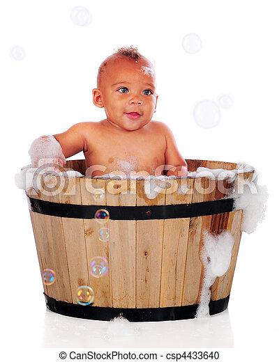 Bubble bath baby. An adorable biracial baby bathing with... stock ...