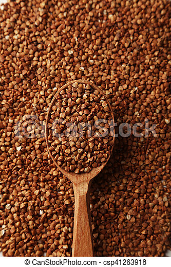Buckwheat in a spoon on brown wooden background - csp41263918