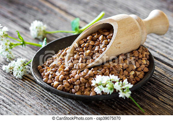 Buckwheat with flower on wooden background - csp39075070