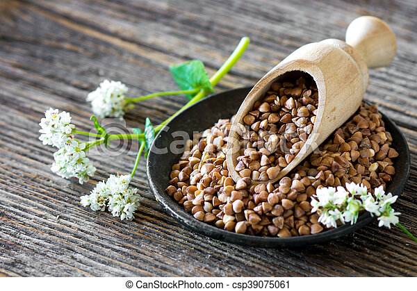 Buckwheat with flower on wooden background - csp39075061