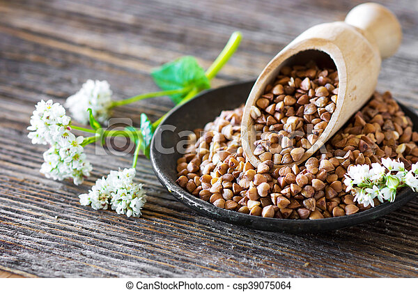 Buckwheat with flower on wooden background - csp39075064