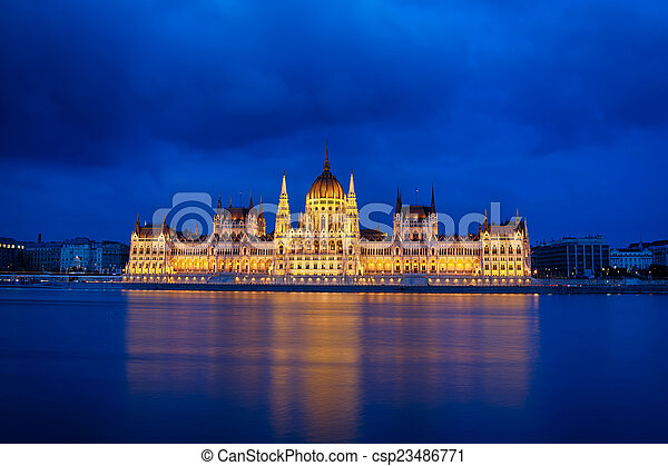 Budapest Parliament at night with reflection in Danube river - csp23486771