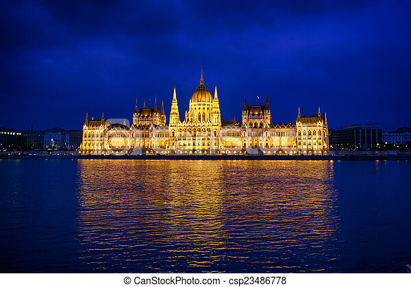 Budapest Parliament at night with reflection in Danube river - csp23486778