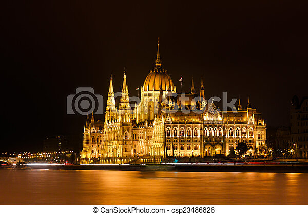 Budapest Parliament at night with reflection in Danube river - csp23486826