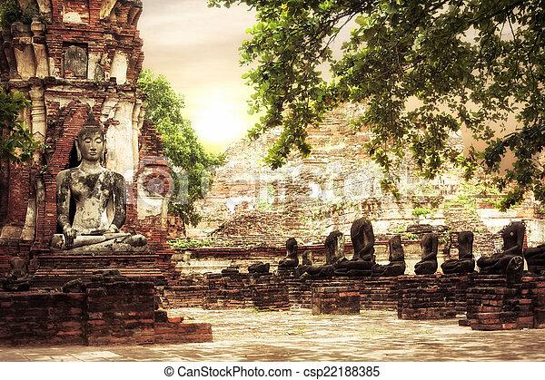 Buddha at Wat Mahathat ruins under sunset sky. Ayutthaya, Thaila - csp22188385