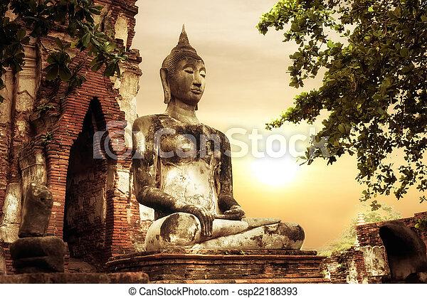 Buddha at Wat Mahathat ruins under sunset sky. Ayutthaya, Thaila - csp22188393