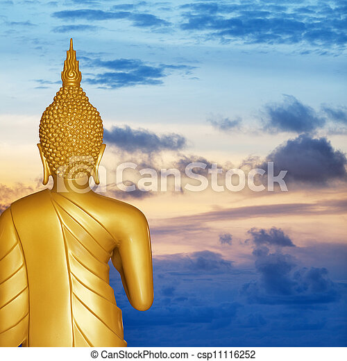 Buddha statue at sunset. Rear view. - csp11116252