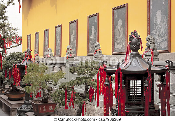 Buddhist Etchings Red Ribbons New Year Sayingts Chinese New Decorations Lanterns Jade Buddha Temple Jufo Si Shanghai China Most famous buddhist temple in Shanghai - csp7906389