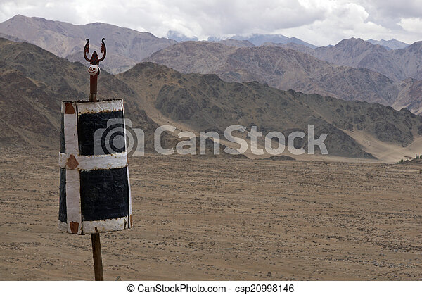 Buddhist flag pole above the dry arid mountains of ladakh in buddhist flag pole csp20998146 sciox Image collections
