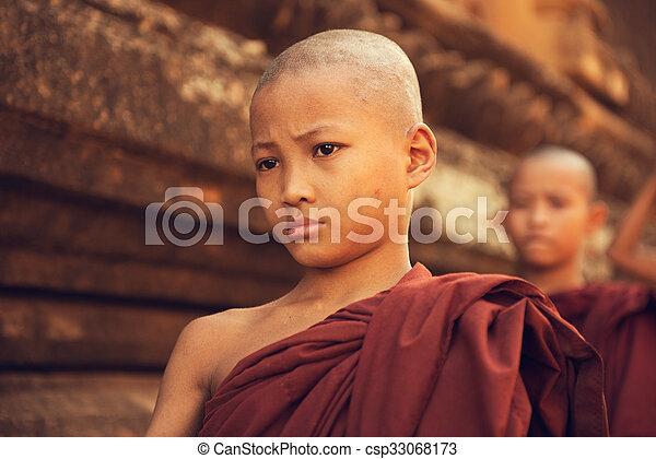 Buddhist novice monks walking morning alms - csp33068173